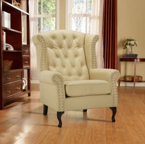 Leather Wing Back Fireside Chair / Armchair with Buttons Cream